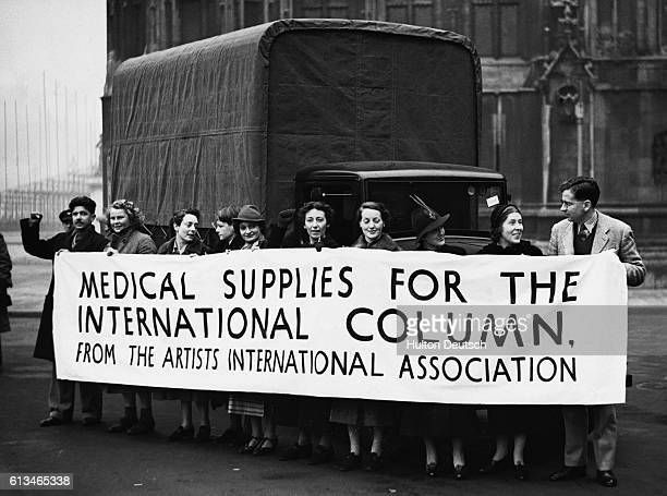 Members of the Artists' International Association beside the ambulance which they raised money to purchase by selling paintings before it left for...