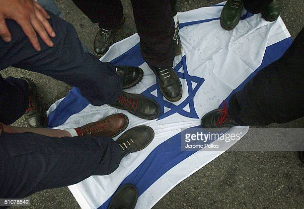 Members of the Aryan Nations step on an Israeli flag during the World Congress Parade held in Coeur d'Alene Idaho on Saturday July 17 2004 Around 40...