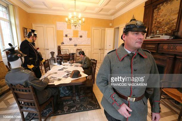 Members of the association 'Le Miroir' in historical dress pose in the Villa Renaudin during a historical reenactment of events of World War One in...