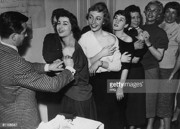 Members of the Association of French Models line up for their smallpox vaccinations, 2nd October 1955.