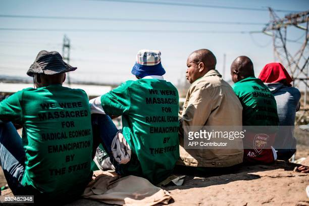 TOPSHOT Members of the Association of Mineworkers and the Marikana community gather to commemorate the fifth anniversary of the Marikana Massacre in...