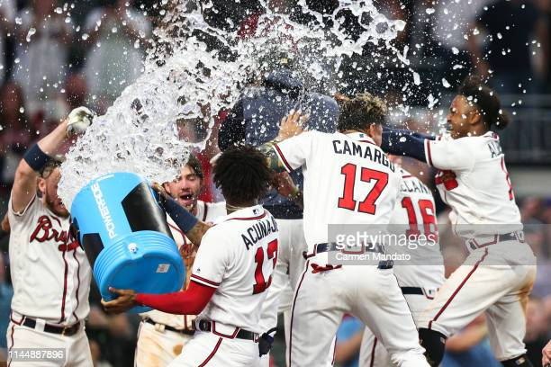Members of the Atlanta Braves celebrate a walk off home run hit by Freddie Freeman in the tenth inning during the game against the Milwaukee Brewers...