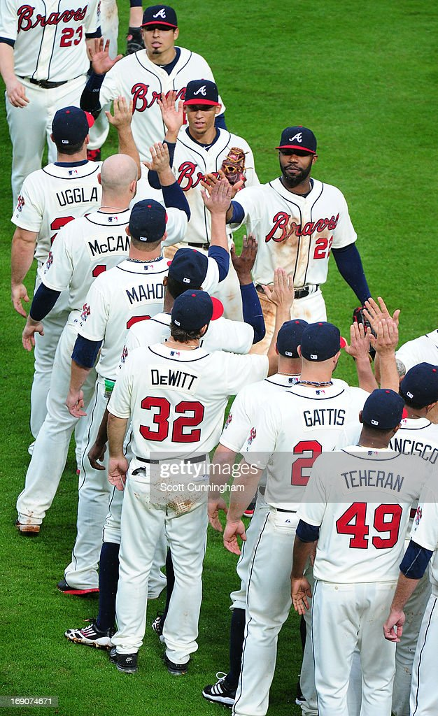Members of the Atlanta Braves celebrate after the game against the Los Angeles Dodgers at Turner Field on May 19, 2013 in Atlanta, Georgia.