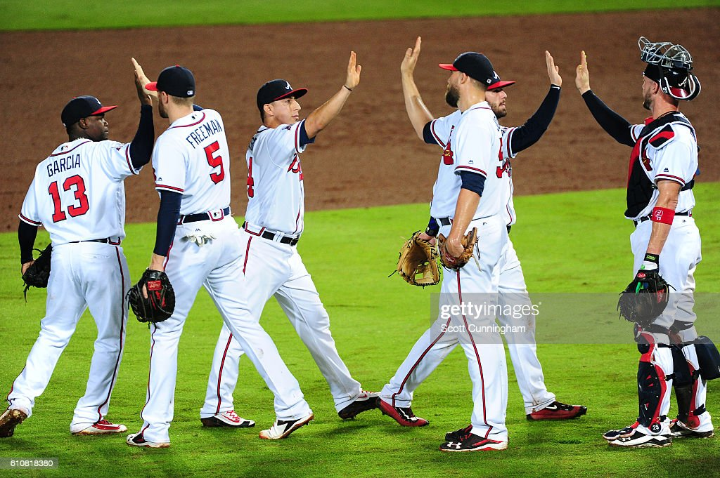 Members of the Atlanta Braves celebrate after the game against the Philadelphia Phillies at Turner Field on September 27, 2016 in Atlanta, Georgia.