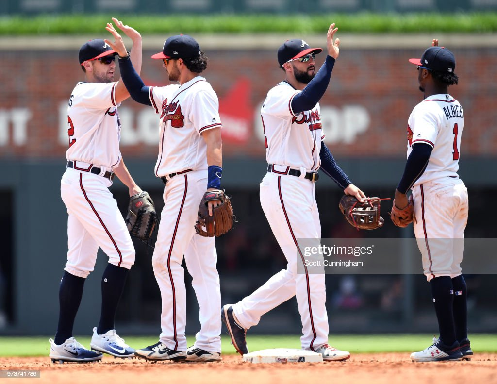 Members of the Atlanta Braves celebrate after the game against the New York Mets at SunTrust Field on June 13, 2018 in Atlanta, Georgia.