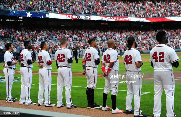 Members of the Atlanta Braves stand during the national anthem wearing number 42 for the game against the San Diego Padres at SunTrust Park on April...