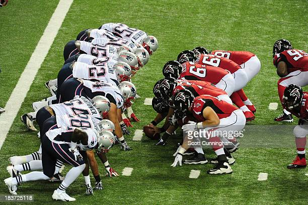 Members of the Atlanta Falcons line up for a kick against the New England Patriots at the Georgia Dome on September 29 2013 in Atlanta Georgia