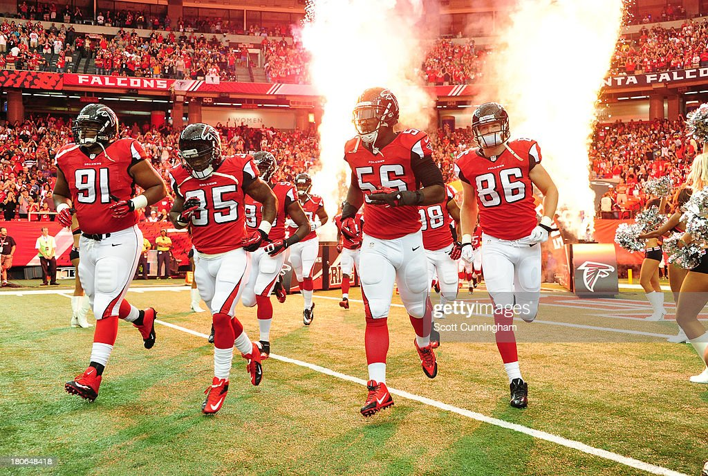 Members of the Atlanta Falcons take the field before the game against the St. Louis Rams at the Georgia Dome on September 15, 2013 in Atlanta, Georgia.