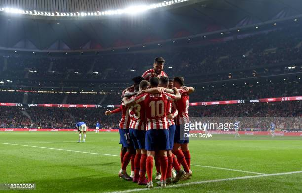 Members of the Atletico de Madrid team celebrate their second goal during the La Liga match between Club Atletico de Madrid and Athletic Club at...