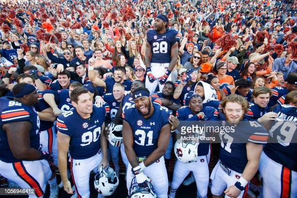 Members of the Auburn Tigers celebrate with fans after defeating the Texas AM Aggies at JordanHare Stadium on November 3 2018 in Auburn Alabama