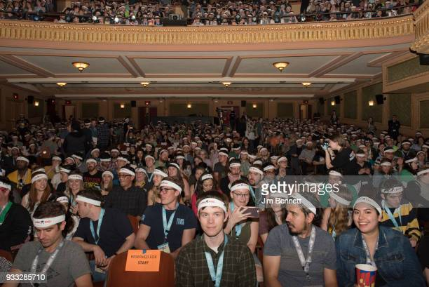 Members of the audience are all wearing headbands provided to them reading Pro Dog before the start of the North American premiere of the film Isle...