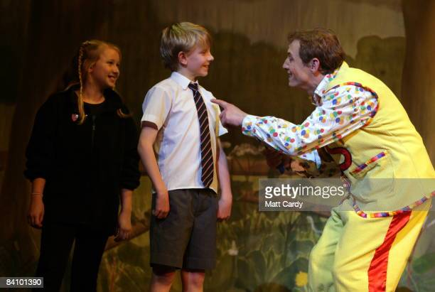 Members of the audience are brought onto the stage with Jon Monie who plays Simple Simon during the traditional pantomime Jack and the Beanstalk at...