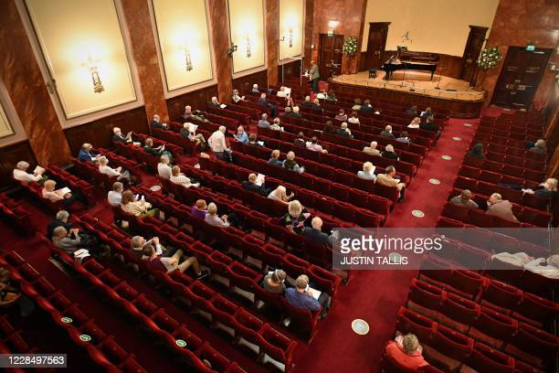 Members of the audience arrive to take their socially distanced seats in the auditorium for a performance by German baritone Christian Gerhaher and...