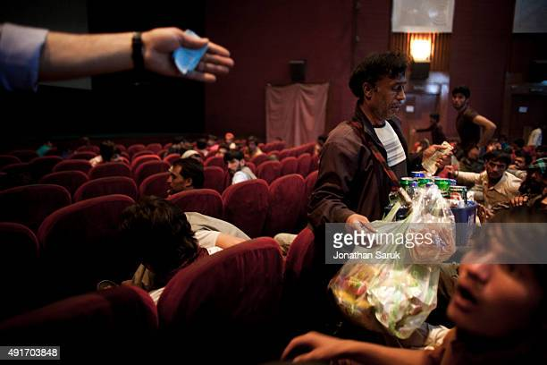 Members of the audience at Ariana Cinema purchase concessions during the intermission in an Indian movie June 4 2011 in Kabul Afghanistan Going to...