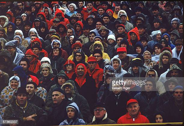 Members of the audience brave the rain to watch the American professional football team the Green Bay Packers play against the Cleveland Browns in...