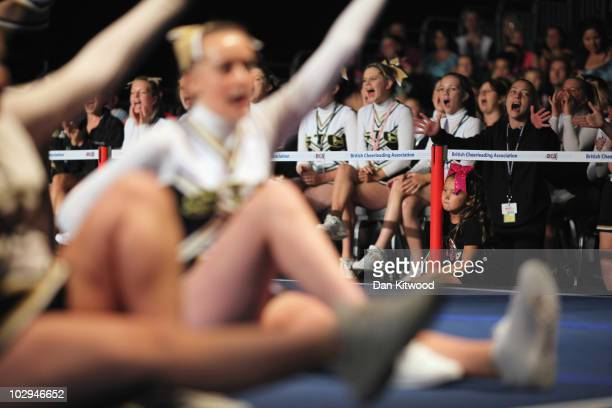Members of the audience enjoy the show as dancers take to the stage at the BCA International Cheerleading and Dance Competition at the Ricoh Arena on...