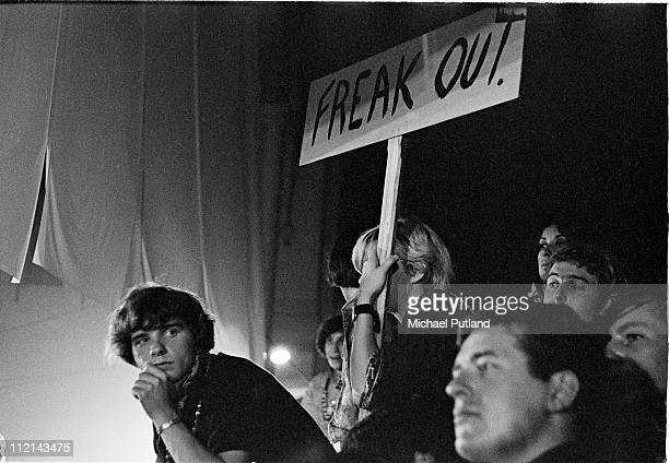 Members of the audience hold a banner reading 'Freak Out' while watching bands performing at the International LoveIn Festival Alexandra Palace...