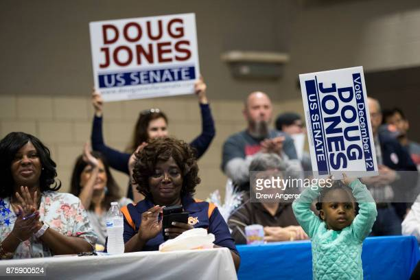 Members of the audience listen as Democratic candidate for US Senate Doug Jones speaks at a fish fry campaign event at Ensley Park November 18 2017...