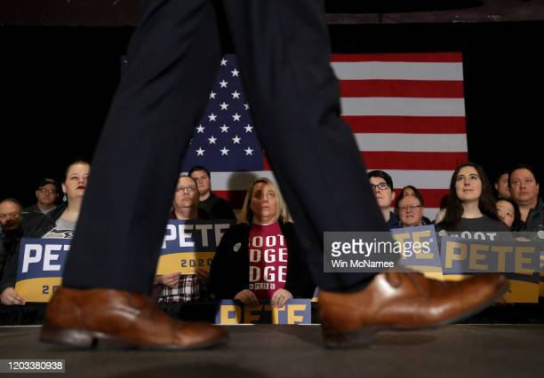 Members of the audience listen as Democratic presidential candidate former South Bend, Indiana Mayor Pete Buttigieg speaks at a Get Out The Caucus...