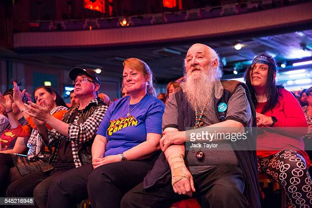 Members of the audience listen to a speaker at a rally in support of Labour Leader Jeremy Corbyn by the grassroots group Momentum at The Troxy on...