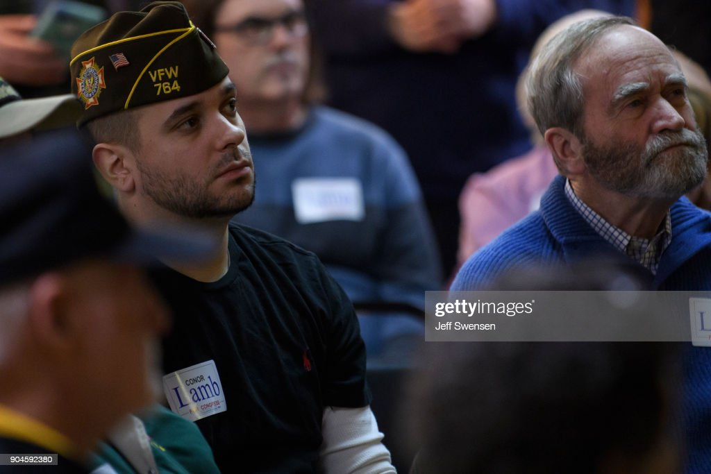 Members of the audience listen to Democrat Conor Lamb, a former U.S. attorney and US Marine Corps veteran running to represent Pennsylvania's 18th congressional district, at the American Legion Post 902 on January 13, 2018 in Houston, Pennsylvania in the southwestern corner of the state. President Donald Trump plans to visit Pennsylvania's 18th Congressional District next week in a bid to help Lamb's republican opponent, Rick Saccone.