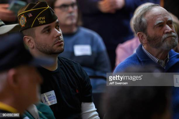 Members of the audience listen to Democrat Conor Lamb a former US attorney and US Marine Corps veteran running to represent Pennsylvania's 18th...