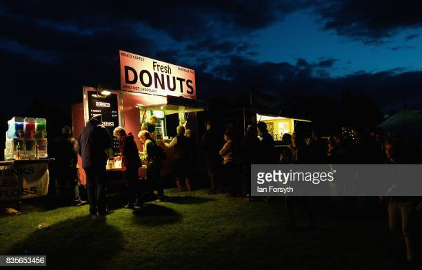 Members of the audience wait for donuts during an interlude at the annual Castle Howard Proms Spectacular concert held on the grounds of the Castle...