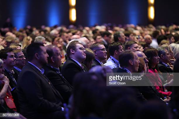 Members of the audience watch the Fox News - Google GOP Debate January 28, 2016 at the Iowa Events Center in Des Moines, Iowa. Residents of Iowa will...