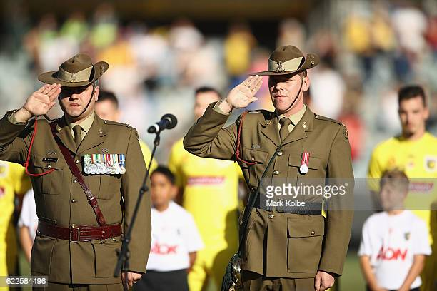 Members of the Australia Defence Force salute during the national anthems in the Remembrance Round prematch ceremony during the round six ALeague...