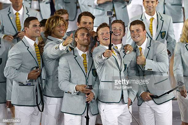 Members of the Australia Olympic Team talk photos during the Opening Ceremony of the Rio 2016 Olympic Games at Maracana Stadium on August 5, 2016 in...