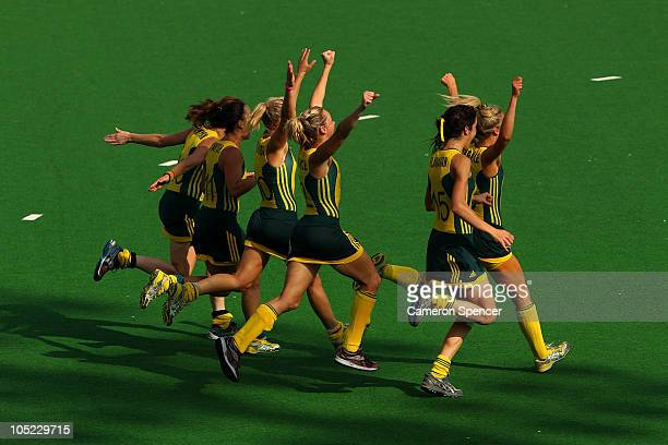 Members of the Australia team celebrate after claiming gold in the women's finals gold medal match between Australia and New Zealand at the Major...