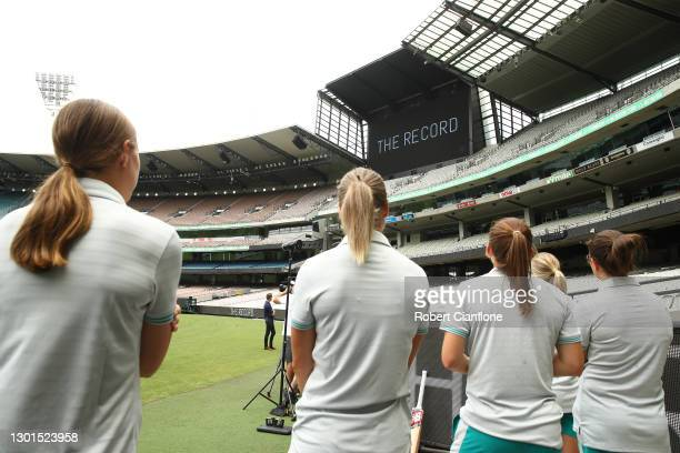 Members of the Australian cricket team watch the big screen during the launch of THE RECORD documentary by Amazon Prime featuring the Australian...