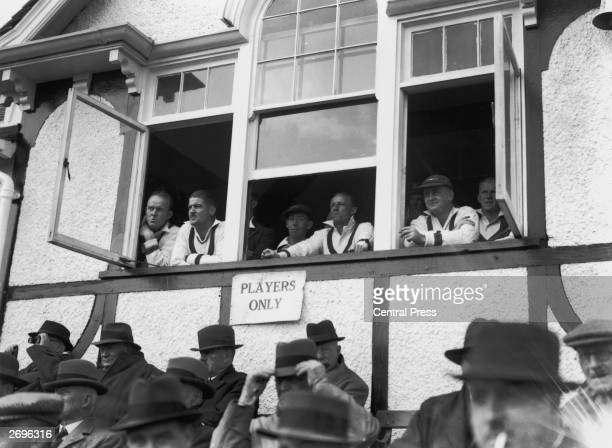 Members of the Australian Cricket Team watching on during their first tour match against Worcester From left to right Bill 'Tiger' O'Reilly Chuck...