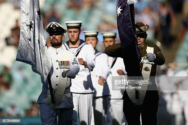 Members of the Australian Defence Force march during a Remembrance Day ceremony during the round six ALeague match between the Sydney Kings and the...