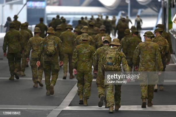 Members of the Australian Defence Force walk through the city on July 27, 2020 in Melbourne, Australia. Victoria has recorded 532 new cases of...