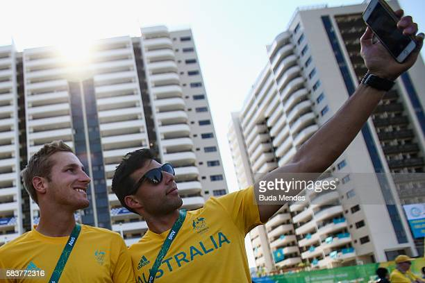 Members of the Australian hockey team take pictures at the Olympic Village before a ceremony with Rio's mayor on July 26 2016 in Rio de Janeiro Brazil