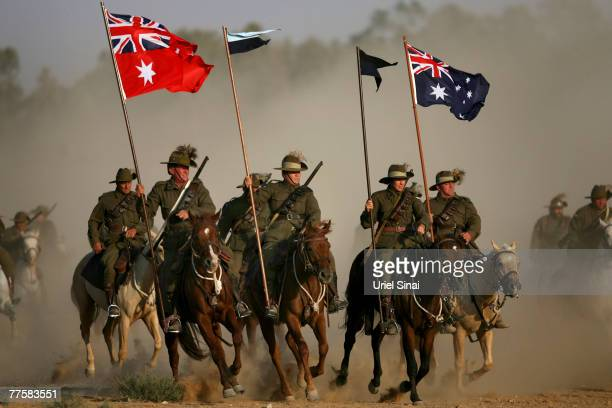 Members of the Australian Infantry Honor Guard ride their horses into the city of Beersheva to commemorate the 90th anniversary of the Battle of...