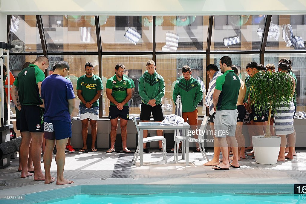 Members of the Australian Kangaroos team observe a minutes silence for Rememberance Day during an Australian Kangaroos media session at InterContinental Hotel Wellington on November 11, 2014 in Wellington, New Zealand.