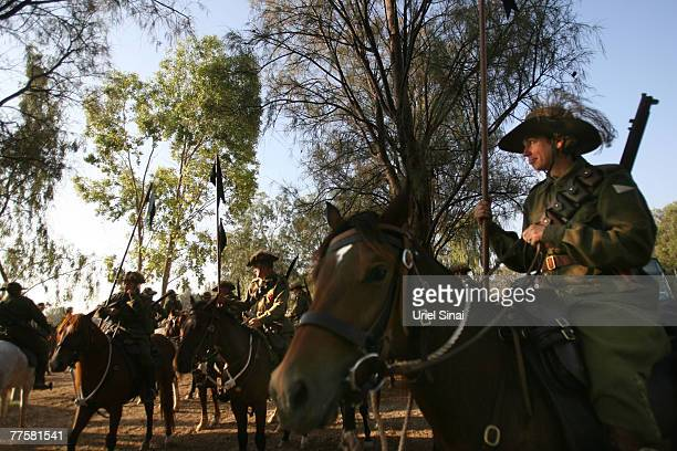 Members of the Australian light horse association honor gourd ride their horses into the old city of Beersheva on the 90th anniversary of the World...