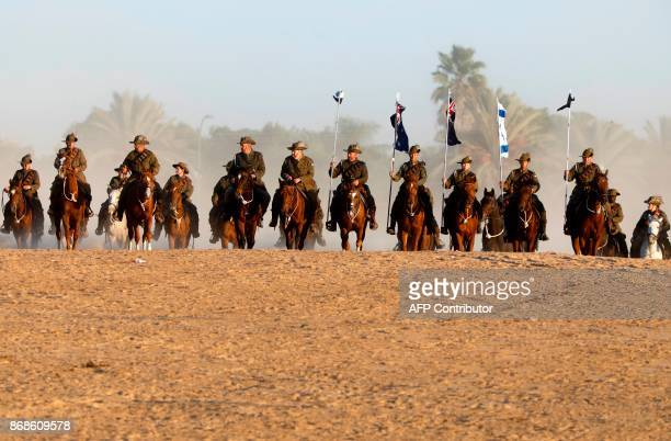 Members of the Australian Light Horse association ride near Beersheva in the southern Israeli desert on October 31 2017 during a reenactment of the...
