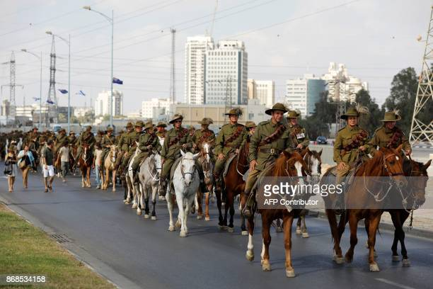Members of the Australian Light Horse association ride through Beersheba in the northern Israeli desert on October 31 ahead of a reenactment of the...