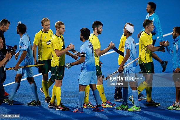 Members of the Australian men's hockey and the Inadian men's hockey team shake hands after the FIH Men's Hero Hockey Champions Trophy 2016 final...