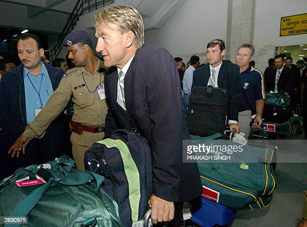 Members of the Australian national cricket team arrives at Indira Ghandi International Airport in New Delhi late 22 October 2003 Australia arrives in...