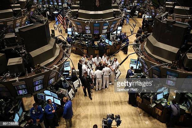 Members of the Australian Navy in town with their ship the HMAS Ballarat take a tour on the floor of the New York Stock Exchange on July 21 2009 in...