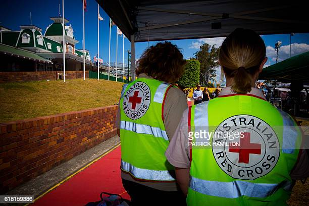 Members of the Australian Red Cross counselling team are seen at the Dreamworld theme park on the Gold Coast on October 26 a day after four people...