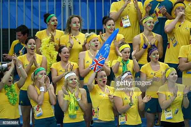 Members of the Australian swim team cheer for teammate Grant Hackett of Australia as he competes in the Men's 1500m Freestyle event held at the...