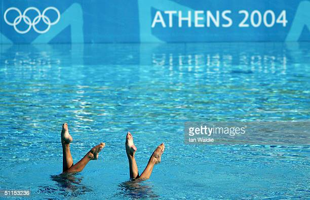Members of the Australian synchronized swimming pairs team take part in training at the Olympic pool during the final days before the start of the...