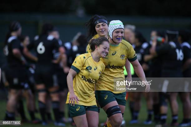 Members of the Australian team celebrate after scoring a try during the International Women's Test match between the New Zealand Silver Ferns and the...