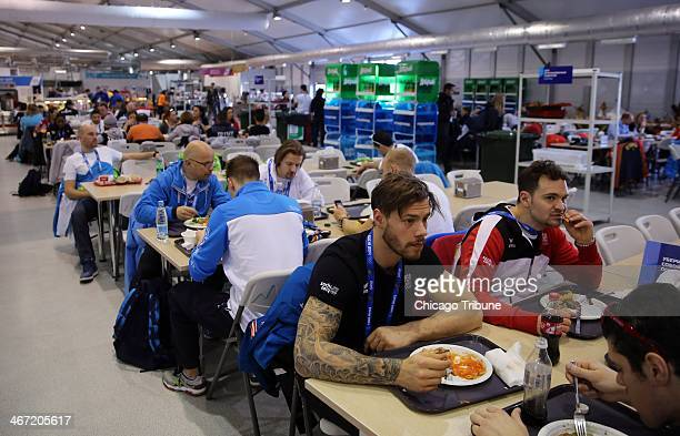 Members of the Austrian team eat at the athletes' dining hall in the Olympic Village at the Winter Olympics in Sochi Russia Thursday Feb 6 2014