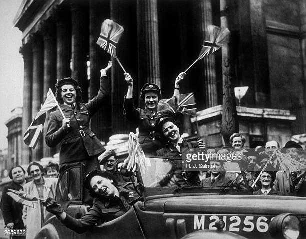 Soldiers from the Women's Royal Army Corps in their service vehicle driving through Trafalgar Square during the VE Day celebrations in London